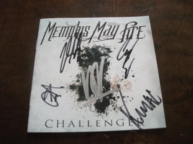 A photo of the Memphis May Fire 'Uncondional' album booklet, signed by the members of the band.